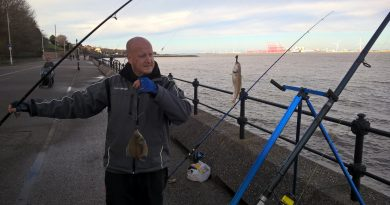 A picture of myself with two fish I just caught from the river mersey