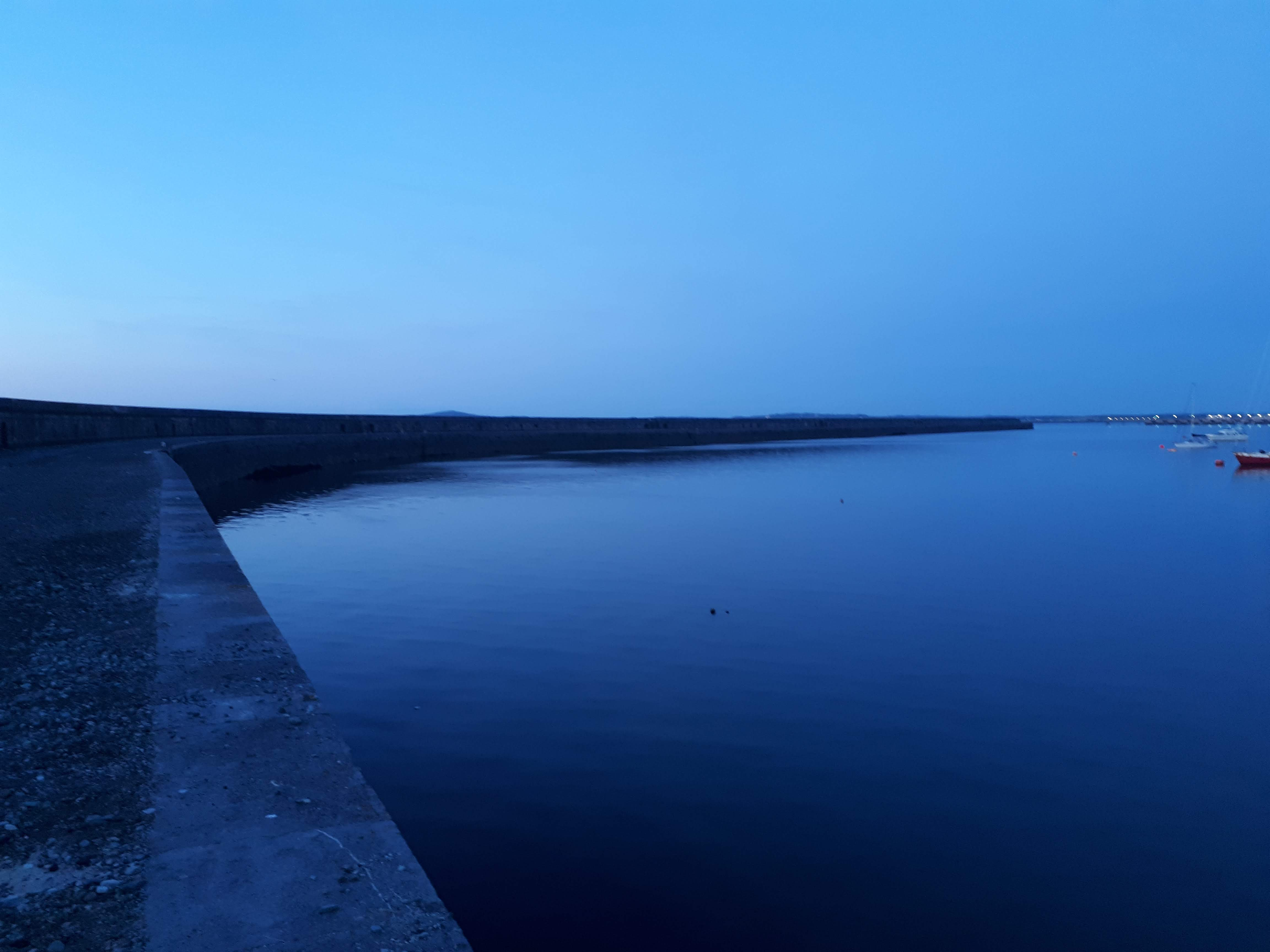 a picture of the breakwater at dusk